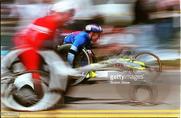 Wheelchair racers climb Heartbreak Hill during Boston Marathon In back is Jean Driscoll winner of the women's wheelchair race