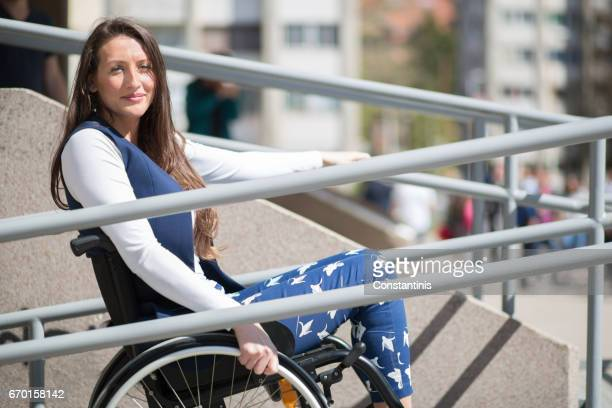 wheelchair ramp help for a young woman