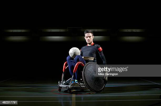 Wheelchair rugby athlete in chair with ball