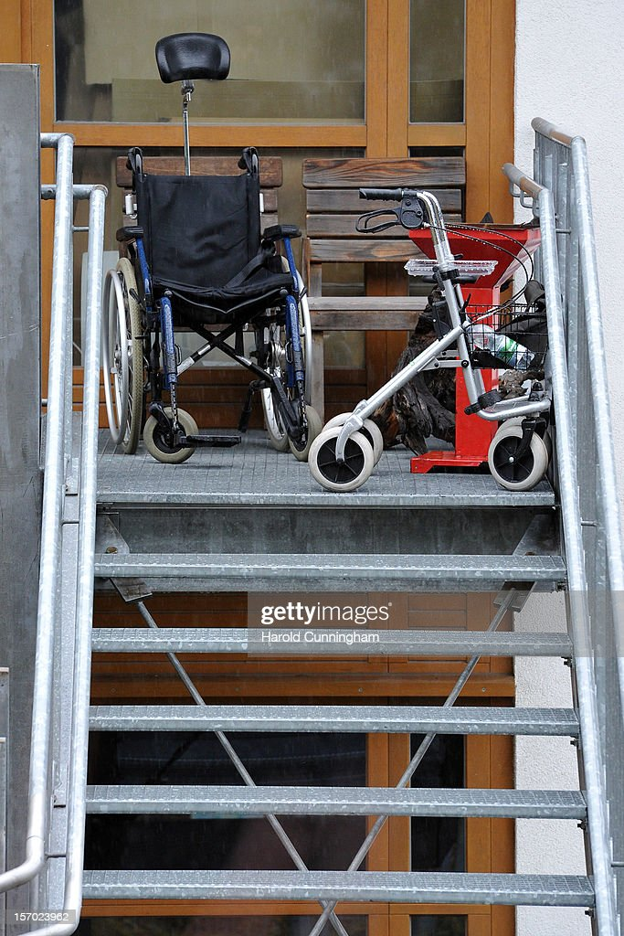 A wheelchair sits at the top of stairs at a Caritas employment facility for handicapped where a fire killed 14 people on November 27, 2012 in Titisee-Neustadt, Germany. The fire was reportedly caused by an explosion at the facility, where approximately 120 people with disabilities are employed in light manufacturing.