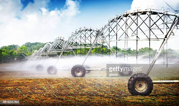 Wheeled irrigation on agricultural soil.