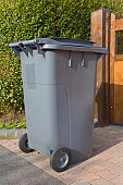 Wheelie bin outside house waiting for refuse collection PR