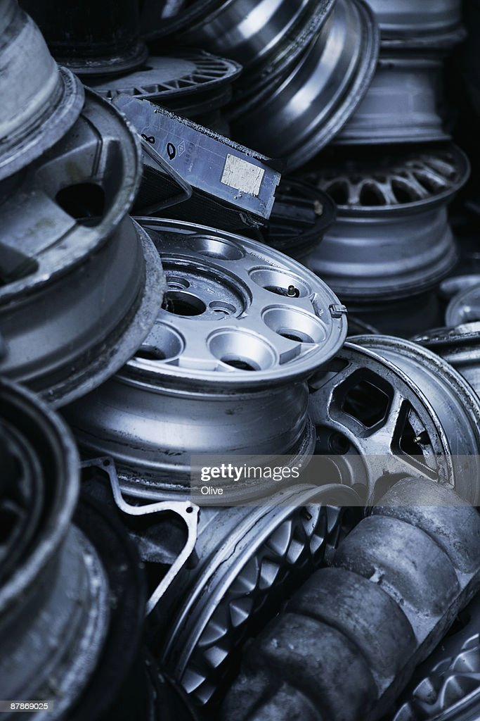 wheels in a scrap yard : Stock Photo
