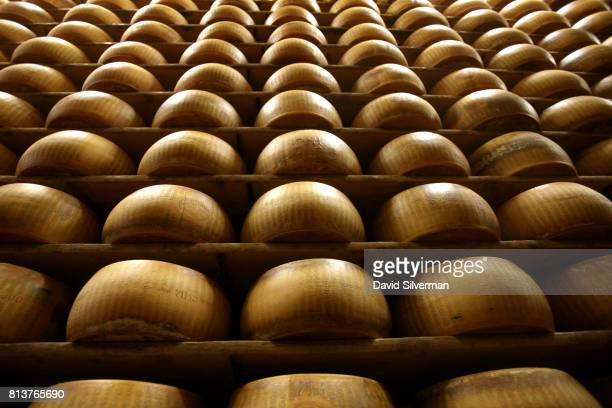 Wheels of ParmigianoReggiano cheese all made in the traditional method age for at least one year but also as long as three years on wooden shelves at...