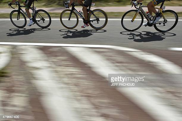 Wheels of riders are pictured during the 1595 km third stage of the 102nd edition of the Tour de France cycling race on July 6 between the belgian...