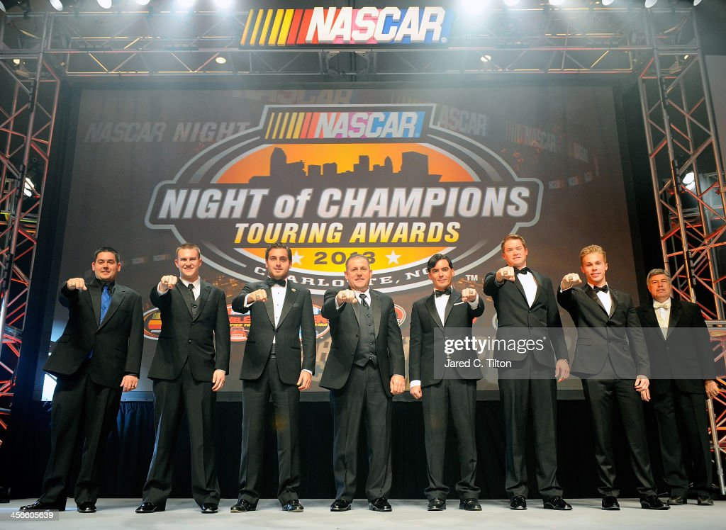 NASCAR Whelen Southern Modified Tour champion George Brunnhoelzl III, NASCAR Whelen Modified Tour champion Ryan Preece, NASCAR Mexico Toyota Series champion Rodrigo Peralta, NASCAR Canadian Tire Series champion Scott Streckly, NASCAR Whelen Euro Series champion, Ander Vilarino, NASCAR K&N Pro Series West champion Derek Thorn, and NASCAR K&N Pro Series East champion Dylan Kwasniewski pose for a photograph during the NASCAR Night of Champions at Charlotte Convention Center on December 14, 2013 in Charlotte, North Carolina.