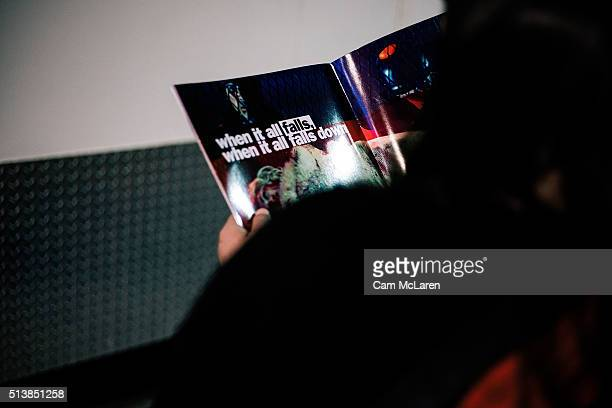 When it all fails when it all falls down Fans read a brochure before the 'Rebel Heart' show at Vector Arena on March 5 2016 in Auckland New Zealand