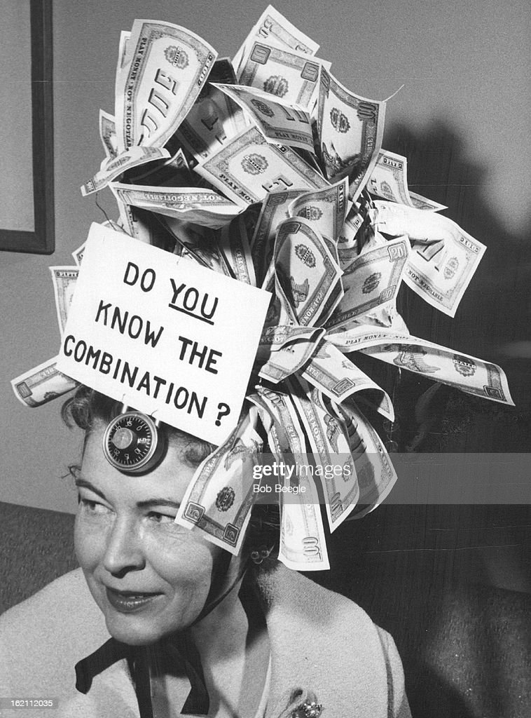 FEB 18 1960, FEB 19 1960; When Money's the object; Mrs. C.C. Wiley of Longmont, chairman of the benevolent fund of the auxiliary to the Colorado Medical Society, wore a hatful of money with a combination lack on her brow plus appropriate sign at crazy hat show.;