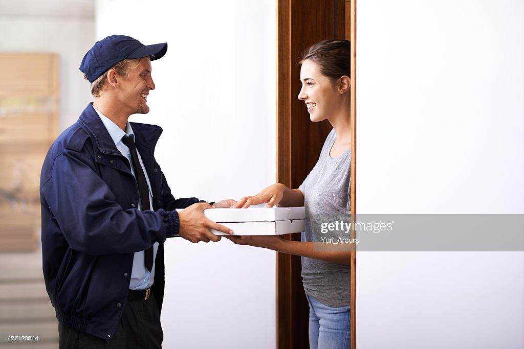 When the cutest pizza delivery guy arrives at your door : Stock Photo