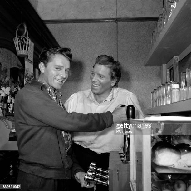 When two top film stars meet at Elstree Studios what's more natural than to have a pint Richard Burton is seen pulling the pint on the pub set of...