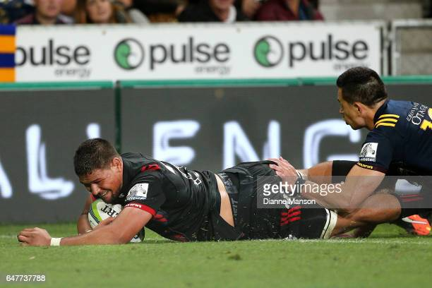 Whetu Douglas of the Crusaders dives over to score a try during the round two Super Rugby match between the Highlanders and the Crusaders at Forsyth...