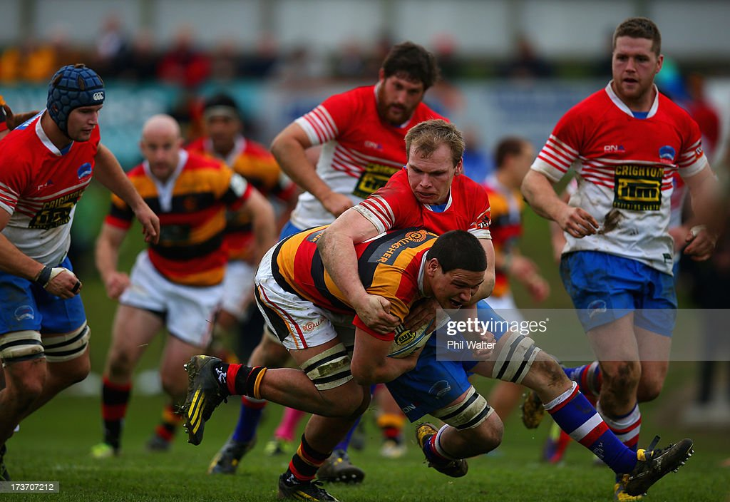 Whetu Douglas of Waikato is tackled by William Lander of Horowhenua-Kapiti during the Ranfurly Shield match between Waikato and Horowhenua-Kapiti at the Morrinsville Domain on July 17, 2013 in Morrinsville, New Zealand.