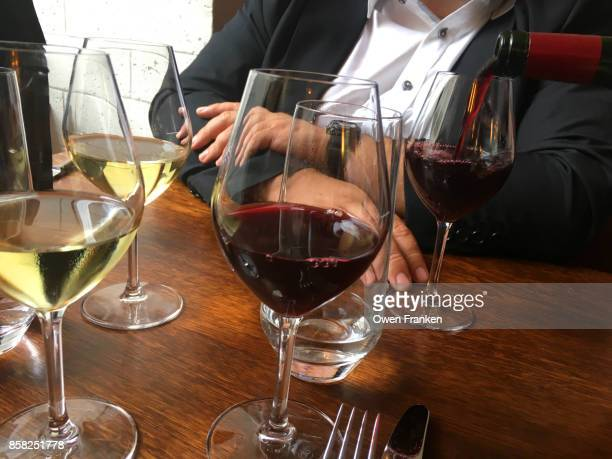 while and red wine in a Paris restaurant during a lunch