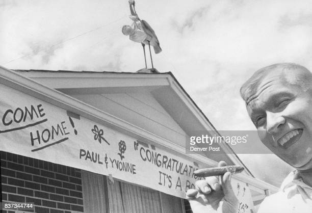 While Dad Was Away Neighbors Were at Play Reuter 1309 S Brentwood Way strike' a pleased pose with cigar after bringing his wife Yvonne and their new...