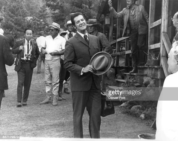 While director Gordon Douglas discusses a scene stars relax Nearly hidden at right of Douglas in white gambler's hat is Mike Connors Robert Cummings...