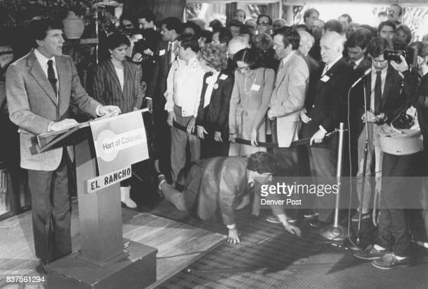 While Gary Hart announced that he wasn't running for Senate he was surrounded by supporters and the Media One media person crawled along the floor to...
