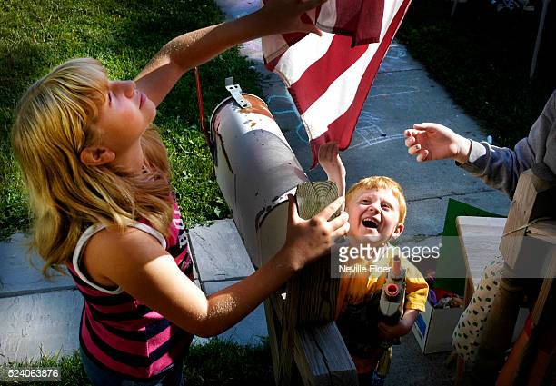 While helping his mother during their garage sale Logan Ostrander and his neighbor Abbie Harris attempt to untangle the American flag The porch is...