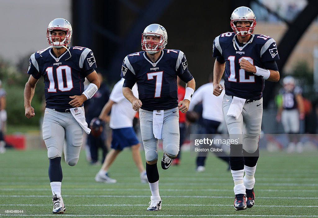 While New England Patriots quarterback <a gi-track='captionPersonalityLinkClicked' href=/galleries/search?phrase=Jimmy+Garoppolo&family=editorial&specificpeople=12185713 ng-click='$event.stopPropagation()'>Jimmy Garoppolo</a> (10) and New England Patriots quarterback <a gi-track='captionPersonalityLinkClicked' href=/galleries/search?phrase=Ryan+Lindley&family=editorial&specificpeople=6235431 ng-click='$event.stopPropagation()'>Ryan Lindley</a> (7) sported smiles, New England Patriots quarterback <a gi-track='captionPersonalityLinkClicked' href=/galleries/search?phrase=Tom+Brady+-+American+Football+Quarterback&family=editorial&specificpeople=201737 ng-click='$event.stopPropagation()'>Tom Brady</a> (12) looked to be in a more serious mood as the three ran onto the field for the pre game warm up. The New England Patriots played the Green Bay Packers in an exhibition game at Gillette Stadium in Foxborough, Mass. on Aug. 13, 2015.