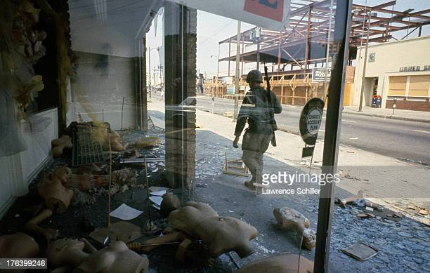 While on patrol a National Guardsman walk as looted storefront on a street in the Watts neighborhood after the declaration of Marshall Law due to...