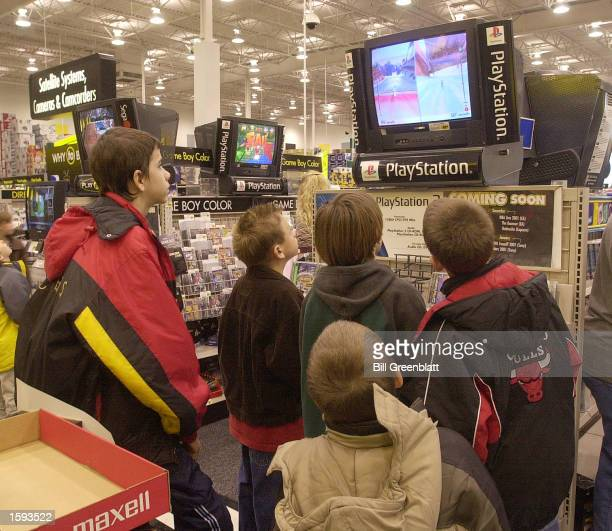 While the adults shop children stop to try out the new Sony Playstation 2 video system November 24 the busiest shopping day of the year known as...