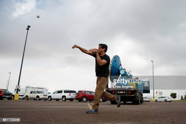 While waiting in a Walmart parking lot for severe thunderstorms to develop Marcus Gutierrez crew member and driver of the Doppler on Wheels vehicle...