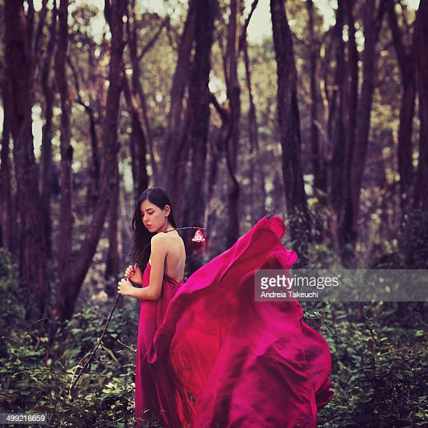 Whimsical girl walking in the forest