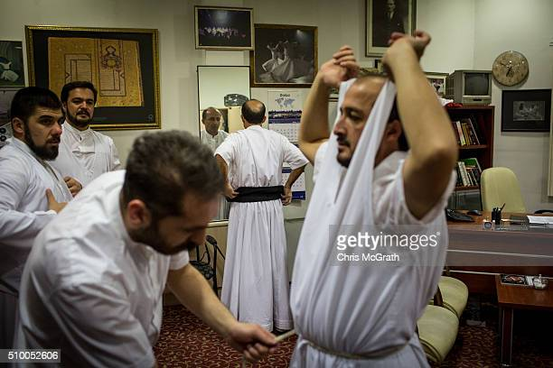 Whirling Dervishes get dressed ahead of performing a Sema ceremony on February 13 2016 in Konya Turkey The Sema ceremony is performed by members of...