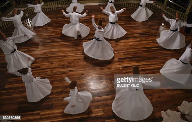 Whirling dervishes perform during a ceremony marking the anniversary of the death of Jelaleddin Mevlana Rumi Sufi mystic poet and founder of the...