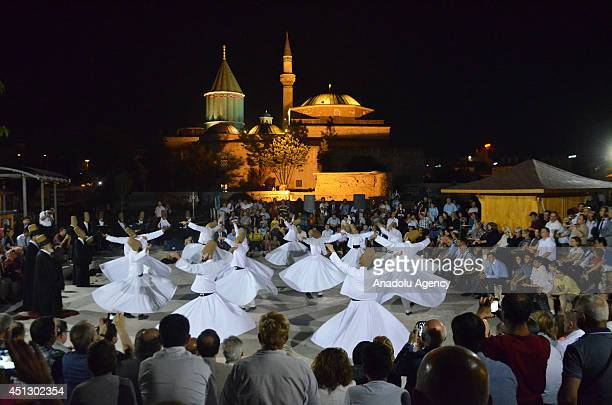 Whirling dervishes perform the Sema during an interuniversity meeting at Mevlana Museum in the central Turkish city of Konya Turkey on June 26 2014...