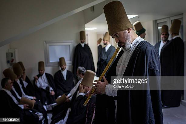 Whirling Dervishes wait backstage before performing a Sema ceremony on February 13 2016 in Konya Turkey The Sema ceremony is performed by members of...