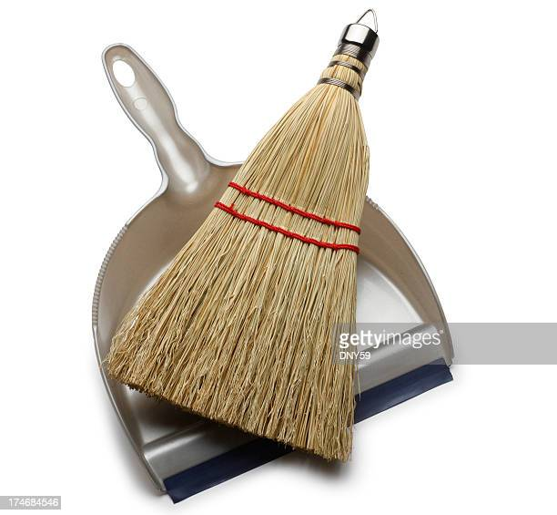 Whisk broom and dustpan on white background