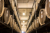 Scotch Whisky Barrel rows. Whiskey and brandy distillery. Oak barrel used to age whiskey.