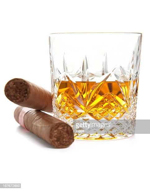 Whiskey and Cuban cigars on white background