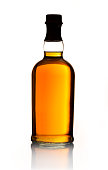 A whiskey bottle with no label isolated on white.