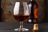Whiskey in glass on rusty table background