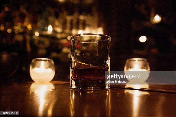 Whiskey, neat, between 2 candles in an NYC bar