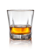 Glass of scotch whiskey on a white