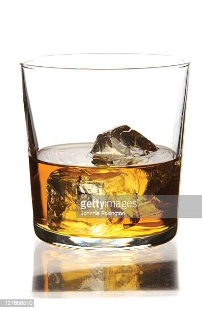 Whisky and ice in glass