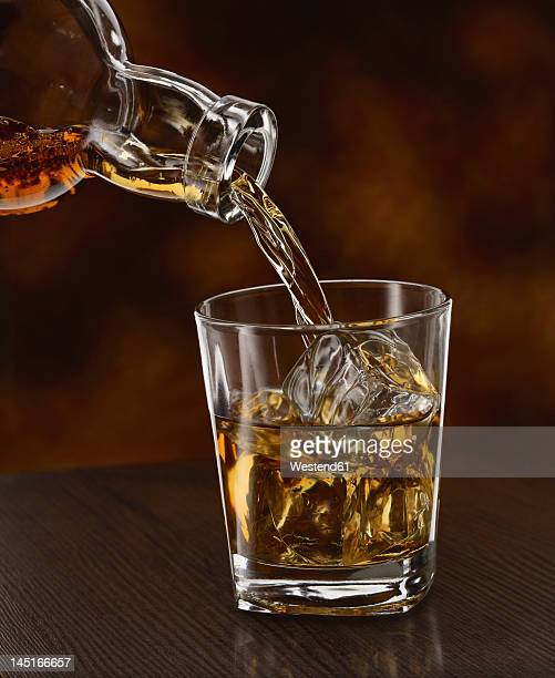 Whisky being poured in a tumbler, close up