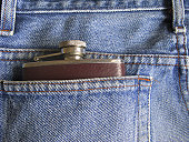 Whisky flask in the back pocket of a pair of jeans