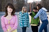 """schoolyard bullies taunt a fellow student, schoolyard setting"""
