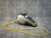 metal whistle isolated on a grey background