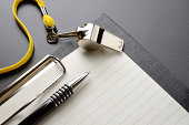 Metal sport whistle with pen and paper sheet