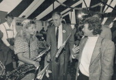 Whistle stop Oompah meets hoopla as the Broadbents visit on Oktoberfest tent in Kitchener yesterday NDP leader Ed and wife Lucille talk to Audrey...