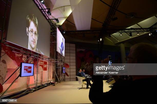 Whistleblower Edward Snowden is broadcast live from Russia at the Sakura Stage at the CeBIT 2017 Technology Trade Fair on March 21 2017 in Hanover...