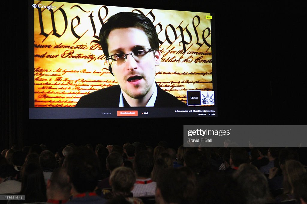 NSA whistleblower <a gi-track='captionPersonalityLinkClicked' href=/galleries/search?phrase=Edward+Snowden&family=editorial&specificpeople=10983676 ng-click='$event.stopPropagation()'>Edward Snowden</a> speaks via videoconference at 'A Virtual Conversation with <a gi-track='captionPersonalityLinkClicked' href=/galleries/search?phrase=Edward+Snowden&family=editorial&specificpeople=10983676 ng-click='$event.stopPropagation()'>Edward Snowden</a>' during the 2014 SXSW Music, Film + Interactive Festival at Austin Convention Center on March 10, 2014 in Austin, Texas.