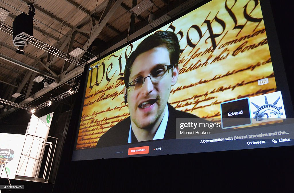 NSA whistleblower <a gi-track='captionPersonalityLinkClicked' href=/galleries/search?phrase=Edward+Snowden&family=editorial&specificpeople=10983676 ng-click='$event.stopPropagation()'>Edward Snowden</a> speaks via videoconference at the 'Virtual Conversation With <a gi-track='captionPersonalityLinkClicked' href=/galleries/search?phrase=Edward+Snowden&family=editorial&specificpeople=10983676 ng-click='$event.stopPropagation()'>Edward Snowden</a>' during the 2014 SXSW Music, Film + Interactive Festival at the Austin Convention Center on March 10, 2014 in Austin, Texas.