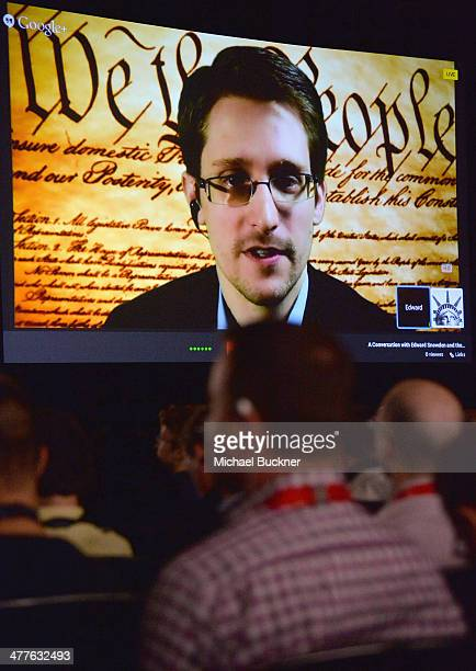 NSA whistleblower Edward Snowden speaks via videoconference at the 'Virtual Conversation With Edward Snowden' during the 2014 SXSW Music Film...