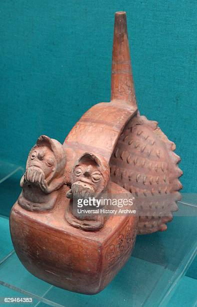 Whistling pot with two figures playing panpipes From LambayequeChimu Peru Dated 13th Century
