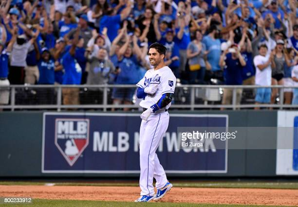 Whit Merrifield of the Kansas City Royals celebrates his gamewinning tworun double in the ninth inning against the Toronto Blue Jays at Kauffman...
